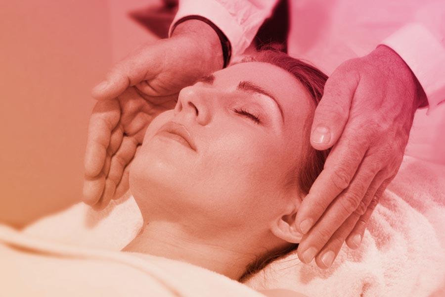 woman having healing treatment